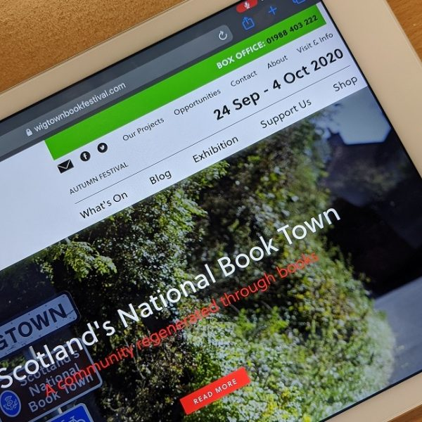 image of the wigtown book festival website on a tablet mobile device